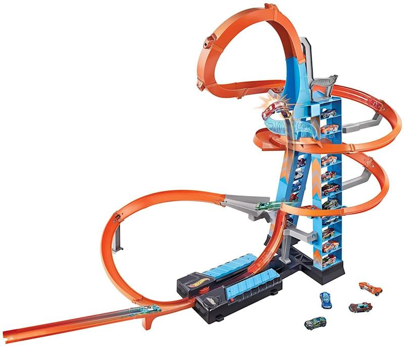 """<a href=""""https://amzn.to/2He4q5C"""" target=""""_blank"""" rel=""""noopener noreferrer"""">This Hot Wheels track</a> set has a tower that can store 20 cars, and kids can race multiple ones at the same time. The loops are meant for midair stunts. The set comes with one car, so you'll have to stock up on a few for the kids to race away.<a href=""""https://amzn.to/2He4q5C"""" target=""""_blank"""" rel=""""noopener noreferrer"""">Find it for $50 at Amazon</a>."""