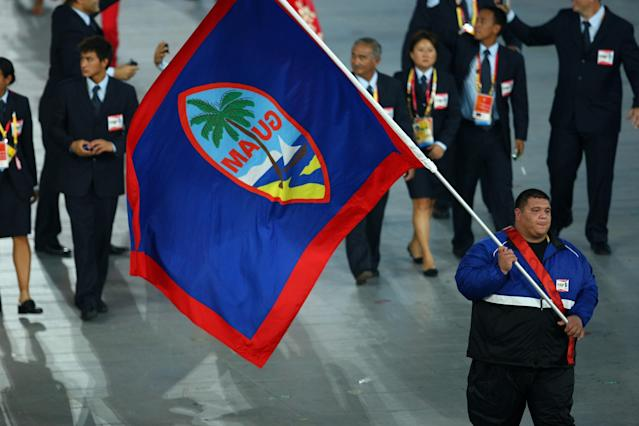 BEIJING - AUGUST 08: Ricardo Blas of Guam carries his country's flag during the Opening Ceremony for the 2008 Beijing Summer Olympics at the National Stadium on August 8, 2008 in Beijing, China. (Photo by Vladimir Rys/Bongarts/Getty Images)