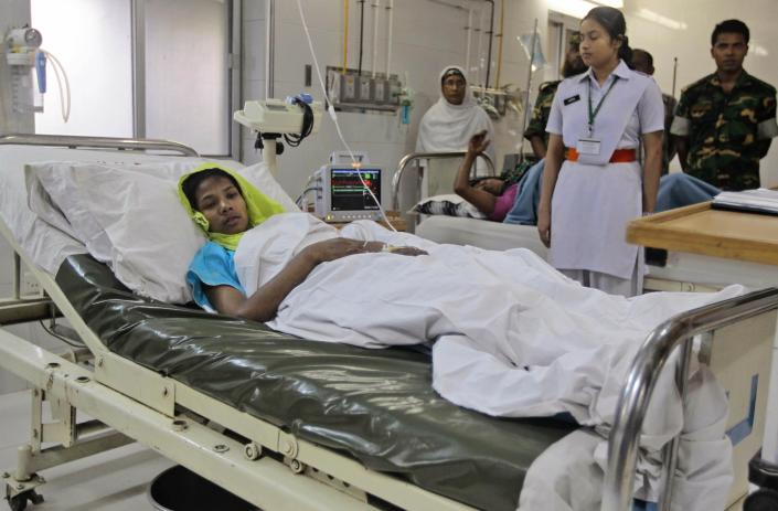 Reshma Begum, who survived 17 days before being rescued from a collapsed garment factory building, receives treatment at a hospital in Savar, near Dhaka, Bangladesh, Saturday, May 11, 2013. Begum was exhausted, panicked and dehydrated as she recovered in a Bangladeshi hospital Saturday, but she was generally in good shape, according to her doctors. (AP Photo/Ismail Ferdous)