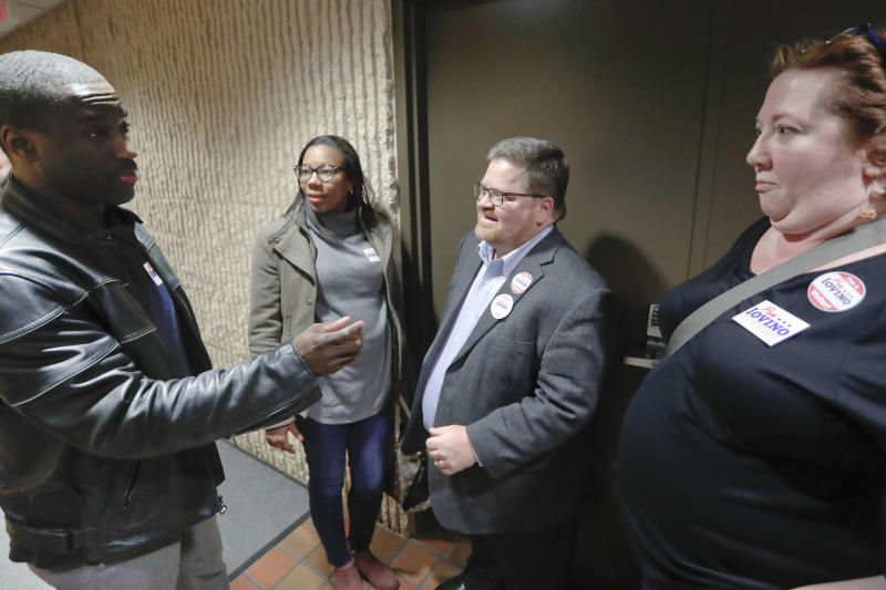CORRECTS SPELLING OF LAST NAME TO WESSELL INSTEAD OF WESSEL - In this April 2, 2019, photo, Mike Wessell, center right, stands with bis wife Kristin Wessell, right, while talking with other supporters for Democratic party candidate for Pennsylvania state senator Pam Iovino at her election returns party in Pittsburgh. Some Democrats thought they didn't need white male voters in 2016. But the party knows it needs them in 2020. (AP Photo/Keith Srakocic)