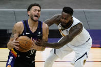 Phoenix Suns forward Abdel Nader (11) is fouled by Denver Nuggets forward JaMychal Green during the second half of an NBA basketball game Saturday, Jan. 23, 2021, in Phoenix. (AP Photo/Rick Scuteri)