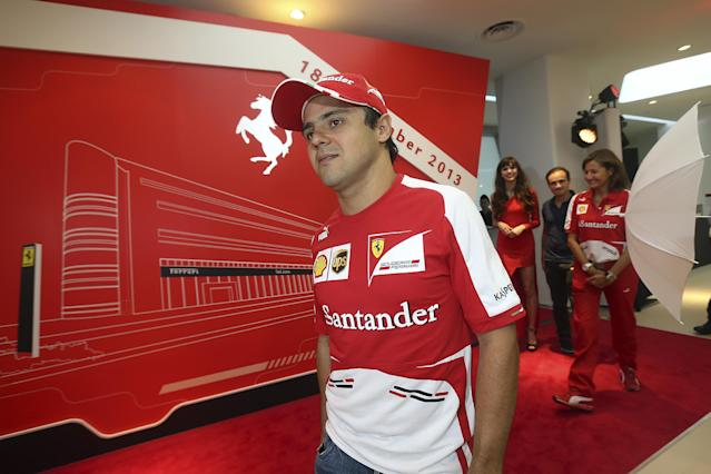Ferrari driver Felipe Massa, of Brazil, attends the opening of a new Ferrari showroom on Wednesday, Sept. 18, 2013, ahead of the Formula One Singapore Grand Prix to be held Sunday in Singapore.(AP Photo/Wong Maye-E)