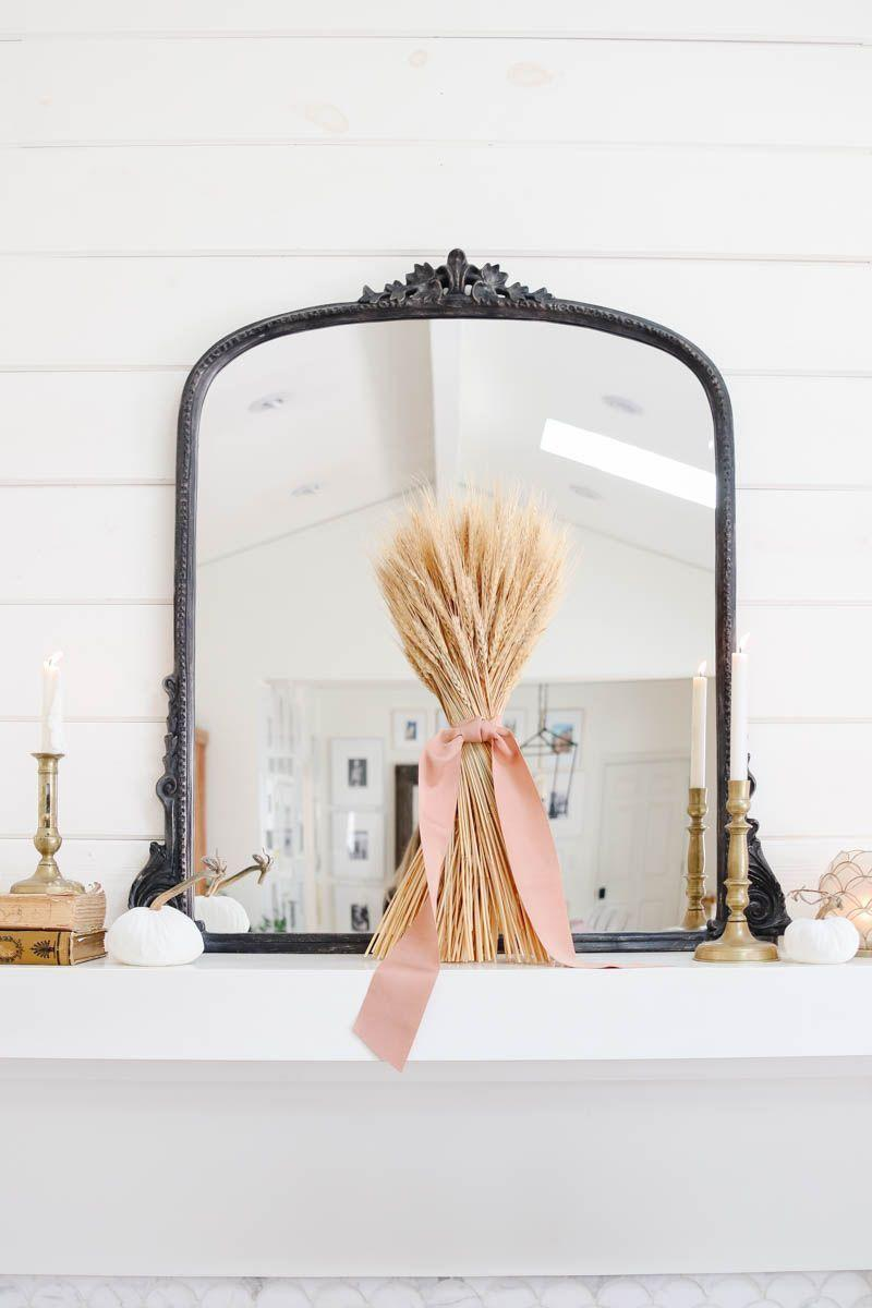 """<p>You can represent harvest season with this bundle of wheat showcased on your mantel. </p><p><strong>Get the tutorial at <a href=""""https://www.modern-glam.com/fall-mantel-decorated-with-antiques-and-wheat/"""" rel=""""nofollow noopener"""" target=""""_blank"""" data-ylk=""""slk:Modern Glam"""" class=""""link rapid-noclick-resp"""">Modern Glam</a>.</strong></p><p><a class=""""link rapid-noclick-resp"""" href=""""https://go.redirectingat.com?id=74968X1596630&url=https%3A%2F%2Fwww.walmart.com%2Fip%2FOffray-7-8-x-18-Carnation-Pink-Grosgrain-Ribbon-1-Each%2F188894826&sref=https%3A%2F%2Fwww.thepioneerwoman.com%2Fhome-lifestyle%2Fcrafts-diy%2Fg36891743%2Ffall-mantel-decorations%2F"""" rel=""""nofollow noopener"""" target=""""_blank"""" data-ylk=""""slk:SHOP RIBBON"""">SHOP RIBBON</a></p>"""