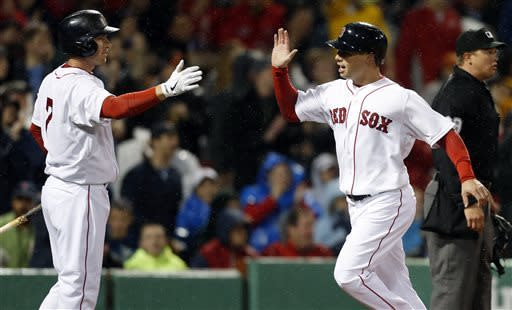 Boston Red Sox's Daniel Nava, right, celebrates with Stephen Drew after scoring on a double by Jarrod Saltalamacchia in the second inning of a baseball game against the Baltimore Orioles in Boston, Wednesday, April 10, 2013. (AP Photo/Michael Dwyer)