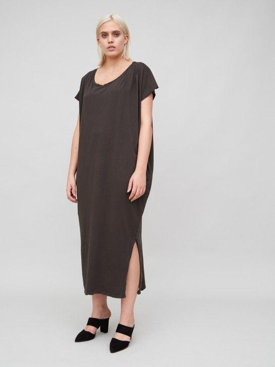 A model wears a cotton maxi T-shirt dress with a high side slit