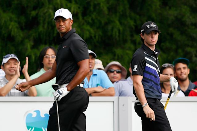 FARMINGDALE, NY - AUGUST 23: Rory McIlroy (R) of Northern Ireland and Tiger Woods look on from the tee box on the 11th hole during the First Round of The Barclays on the Black Course at Bethpage State Park August 23, 2012 in Farmingdale, New York. (Photo by Kevin C. Cox/Getty Images)