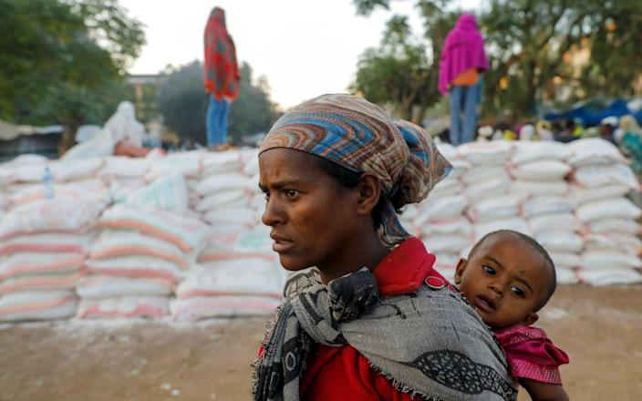 A woman queuing for food at the Tsehaye primary school in Shire, Tigray, Ethiopia - Baz Ratner/Reuters