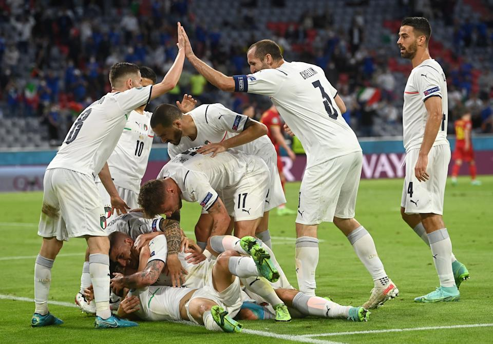 Soccer Football - Euro 2020 - Quarter Final - Belgium v Italy - Football Arena Munich, Munich, Germany - July 2, 2021 Italy's Nicolo Barella celebrates scoring their first goal with teammates Pool via REUTERS/Christof Stache