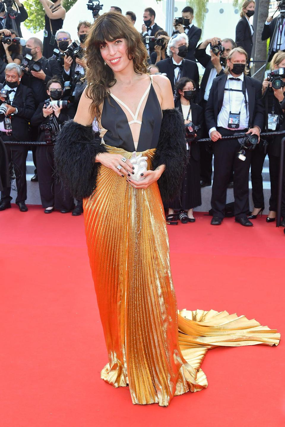 """French singer Lou Doillon wore her heart out in a Gucci gown with caged chest slits that she paired with a fanciful clutch from the brand. <span class=""""copyright"""">Photo: Stephane Cardinale/Corbis/Getty Images/</span>"""