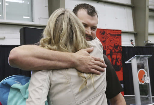 Cleveland Browns' offensive lineman Joe Thomas hugs his wife Annie after his farewell speech to the Browns' owners, coaches, staff and fans during a news conference, Monday, March 19, 2018, at the Browns' headquarters in Berea, Ohio. Thomas is retiring after 11 NFL football seasons. The 10-time Pro Bowler announced his retirement, ending a career marked by durability and dominance. (John Kuntz/The Plain Dealer via AP)