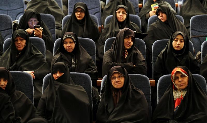 After the second round of elections in Iran a record 17 women will become lawmakers in the 290-seat parliament -- one more than the number of clerics, which has hit an all time low (AFP Photo/Atta Kenare)