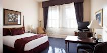 """<p>This <a href=""""https://go.redirectingat.com?id=74968X1596630&url=https%3A%2F%2Fwww.tripadvisor.com%2FHotel_Review-g39143-d92201-Reviews-Hotel_at_Old_Town-Wichita_Kansas.html&sref=https%3A%2F%2Fwww.redbookmag.com%2Fabout%2Fg34149750%2Fmost-historic-hotels%2F"""" rel=""""nofollow noopener"""" target=""""_blank"""" data-ylk=""""slk:Wichita hotel"""" class=""""link rapid-noclick-resp"""">Wichita hotel</a>, a handsome four-story redbrick building with white trim, is one of Kansas' most historic hotels. Built in 1906, it once served as a warehouse facility for the Keen Kutter tool company, and many antique tools are on display throughout the hotel's public spaces. </p>"""