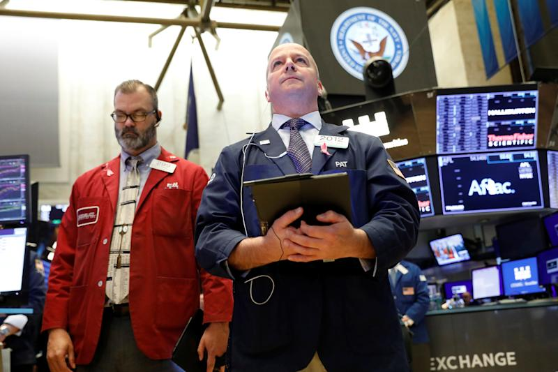 Traders pause for a moment of silence in honor of Veterans Day on the floor at the New York Stock Exchange (NYSE) in New York, U.S., November 11, 2019. REUTERS/Brendan McDermid
