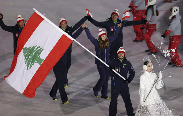 <p>Samer Tawk carries the flag of Lebanon during the opening ceremony of the 2018 Winter Olympics in Pyeongchang, South Korea, Friday, Feb. 9, 2018. (AP Photo/Michael Sohn) </p>