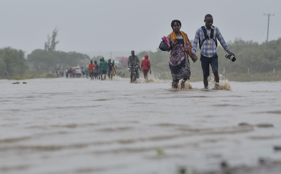 Residents brave the floods in Mazive, southern Mozambique, on April 28, 2019, after a cyclone brought heavy rains. (Photo: EMIDIO JOSINE via Getty Images)
