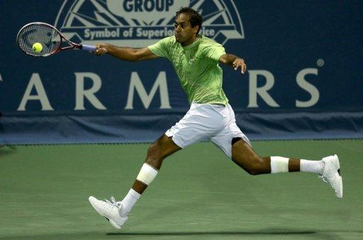 "Rageev Ram returns a shot to Sam Querrey during their Los Angeles Open semi-final match on July 28. ""It was a tough match, he's a serve-and volley guy and knows how to use his slice. I managed to win by serving well to recover the break,"" Querrey said of Ram"