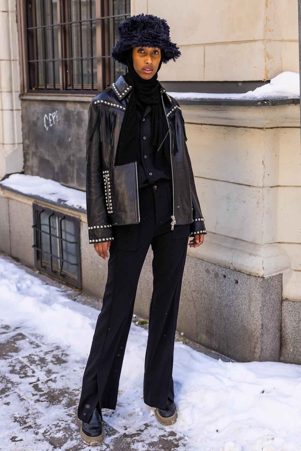 <p>Try contrasting your fuzzy bucket hat with a leather jacket for a fun Western-inspired look.</p>
