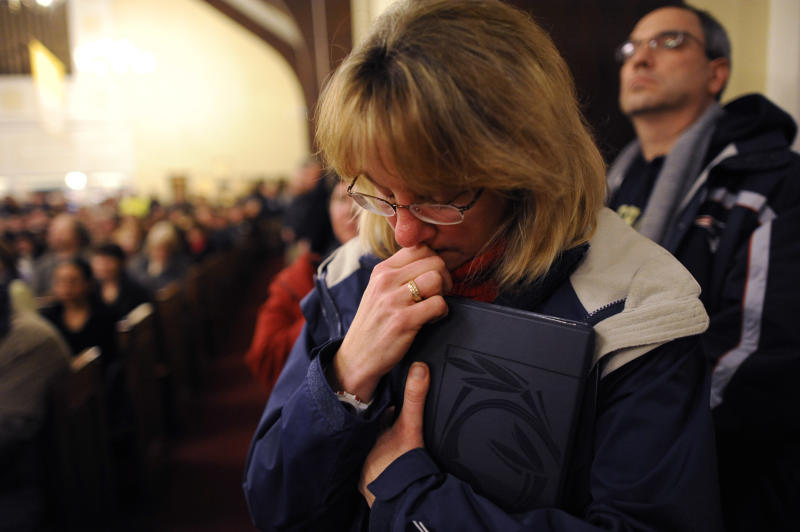 Mourners gather at a vigil service for victims of the Sandy Hook Elementary School shooting, at the St. Rose of Lima Roman Catholic Church in Newtown, Conn. Friday, Dec. 14, 2012. A man killed his mother at their home and then opened fire Friday inside the elementary school where she taught, massacring 26 people, including 20 children, as youngsters cowered in fear to the sound of gunshots reverberating through the building and screams echoing over the intercom (AP Photo/Andrew Gombert, Pool)