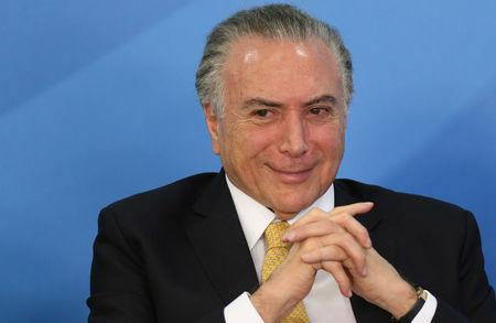Brazil's President Temer smiles during a meeting with trade unionists in Brasilia