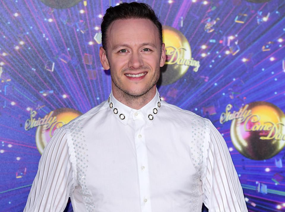 Kevin Clifton has 'I love Glasgow' tattooed on his foot (PA)