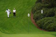 Francesco Molinari, of Italy, walks with a caddie down the sixth fairway during the first round of the Masters golf tournament Friday, Nov. 13, 2020, in Augusta, Ga. (AP Photo/Charlie Riedel)