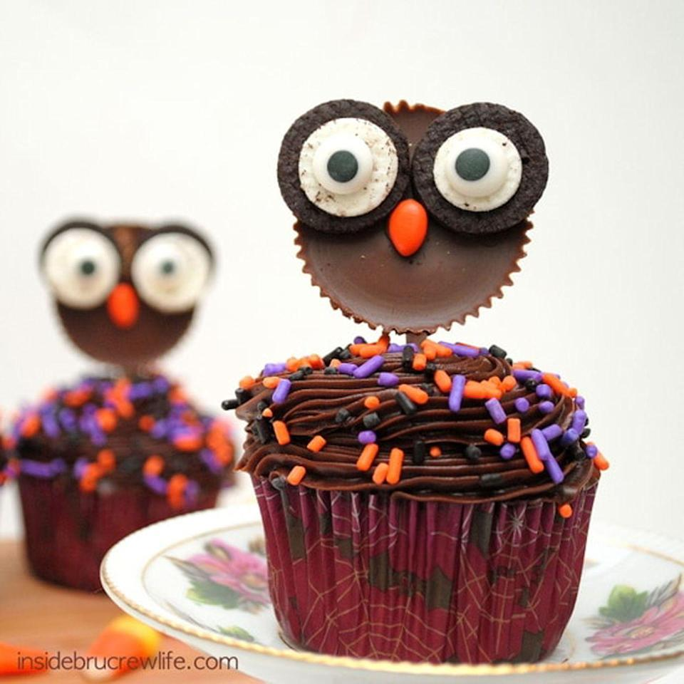 """<p>Use Reese's and Oreos to make wide-eyed owls.</p><p><strong>Get the recipe at </strong><strong><a href=""""https://insidebrucrewlife.com/reeses-owls/"""" rel=""""nofollow noopener"""" target=""""_blank"""" data-ylk=""""slk:Inside BruCrew Life"""" class=""""link rapid-noclick-resp"""">Inside BruCrew Life</a>.</strong></p><p><strong><strong><a class=""""link rapid-noclick-resp"""" href=""""https://www.amazon.com/Wilton-Non-Stick-Muffin-Cupcake-Baking/dp/B00KIFBI1C/?tag=syn-yahoo-20&ascsubtag=%5Bartid%7C10050.g.1366%5Bsrc%7Cyahoo-us"""" rel=""""nofollow noopener"""" target=""""_blank"""" data-ylk=""""slk:SHOP CUPCAKE TINS"""">SHOP CUPCAKE TINS</a></strong><br></strong></p>"""