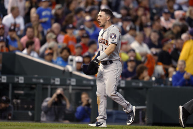 Houston Astros' Alex Bregman reacts after his triple was negated by a call of fan interference when Colorado Rockies left fielder Gerardo Parra tried to catch the ball during the sixth inning of a baseball game Wednesday, July 25, 2018, in Denver. (AP Photo/David Zalubowski)