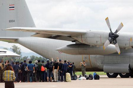 Thai Navy pose for photo at Chiang Rai International Airport after cave rescue mission in Chiang Rai