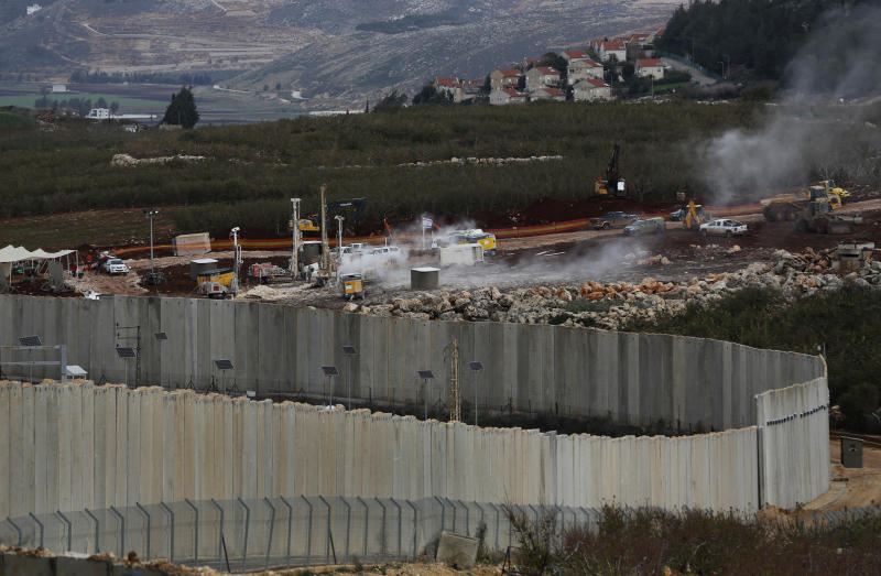 Lebanese and Israeli soldiers in altercation over border fence