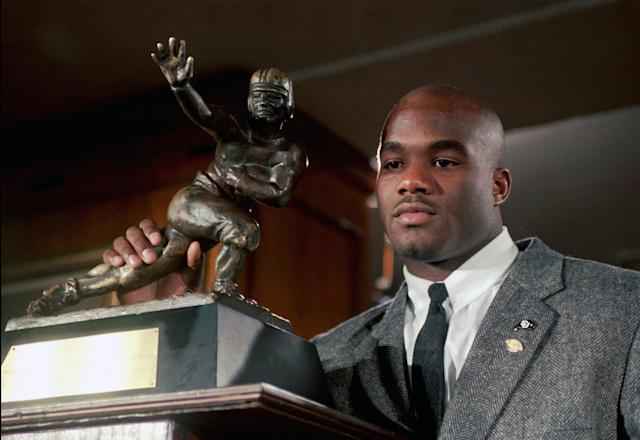 FILE – In this Dec. 10, 1994, file photo, Colorado's Rashaan Salaam poses with his Heisman Trophy at the Downtown Athletic Club in New York. (AP Photo/Adam Nadel, File)