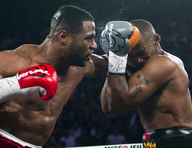 Jean Pascal, from Montreal, lands a left to the head of George Blades, from Indiana, during the fifth round of their middleweight fight Saturday, Sept. 28, 2013 in Montreal. Pascal won with a fifth round TKO.(AP Photo/The Canadian Press, Ryan Remiorz)