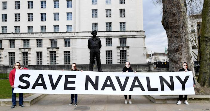 "Supporters of Navalny stage a demonstration organized by the group ""Art of Rebel"" outside Downing Street in London on April 13, 2021.<span class=""copyright"">Facundo Arrizabalaga—EPA-EFE/Shutterstock</span>"