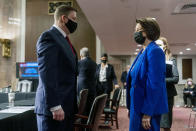 Former U.S. Capitol Police Chief Steven Sund, left, speaks with Chairwoman Sen. Amy Klobuchar, D-Minn., right, before he testifies before a Senate Homeland Security and Governmental Affairs & Senate Rules and Administration joint hearing on Capitol Hill, Washington, Tuesday, Feb. 23, 2021, to examine the January 6th attack on the Capitol. (AP Photo/Andrew Harnik, Pool)
