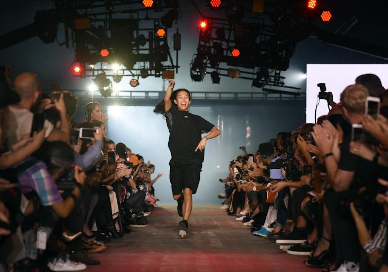 Designer Alexander Wang greets the audience after his Spring 2017 collection is modeled during Fashion Week in New York, Saturday, Sept. 10, 2016. (AP Photo/Diane Bondareff)