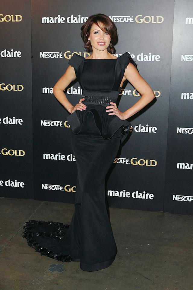"""Kylie Minogue's lil sis Dannii popped a pose at the 2009 Prix de Marie Clarie Awards at Sydney's Royal Hall of Industries in a fabulously futuristic J'Aton Couture gown, complete with a crystal-embellished train. Sergio Dionisio/<a href=""""http://www.gettyimages.com/"""" target=""""new"""">GettyImages.com</a> - April 16, 2009"""