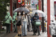 People wearing face masks to help curb the spread of the coronavirus walk around in the famed Asakusa shopping area on a rainy day in Tokyo on Thursday, May 27, 2021. (AP Photo/Hiro Komae)