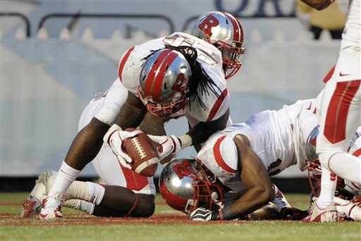 Rutgers linebacker Khaseem Greene (20) recovers a fumble in the end zone for a touchdown during the first quarter of the NCAA college football Russell Athletic Bowl game against Virginia Tech, Friday, Dec. 28, 2012, in Orlando, Fla. (AP Photo/Brian Blanco)