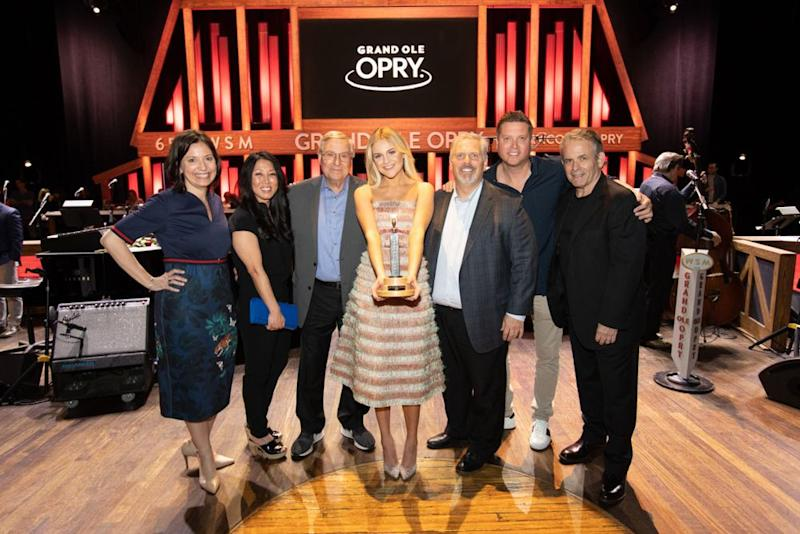 Grand Ole Opry's Sally Williams, Black River Entertainment's Kim and Terry Pegula, Kelsea Ballerini, Black River Entertainment's Gordon Kerr, Sandbox Entertainment's Jason Owen and Black River Entertainment's Rick Froio | Chris Hollo/Grand Ole Opry