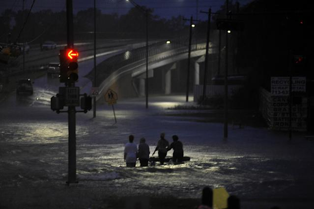 <p>Residents wade through floodwater after Hurricane Harvey inundated the Texas Gulf coast with rain causing widespread flooding, in Houston, Texas, Aug. 28, 2017. (Photo: Nick Oxford/Reuters) </p>