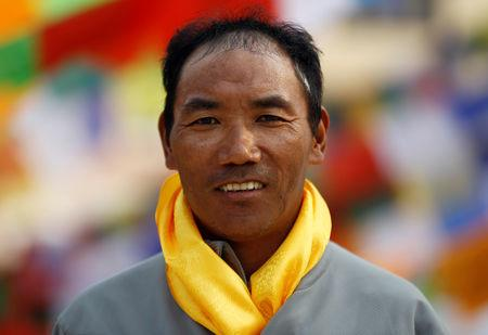 FILE PHOTO:  Kami Rita Sherpa, 48, who is attempting a world record by climbing Mount Everest for the 22nd time this season, poses for a picture at Boudhanath Stupa in Kathmandu, Nepal March 26, 2018. REUTERS/Navesh Chitrakar
