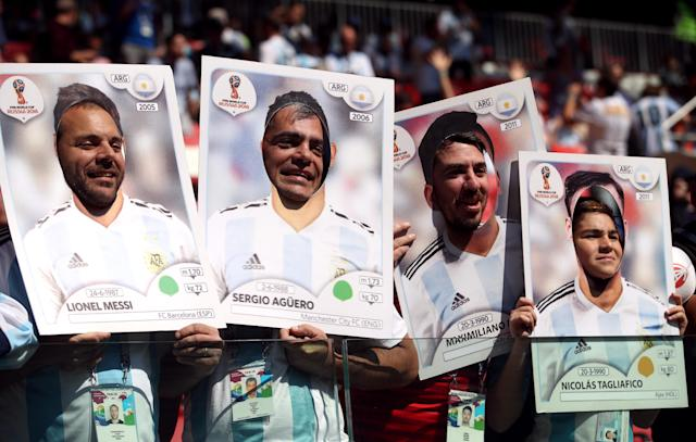 <p>Four Argentina fans wearing giant Panini stickers of Lionel Messi, Sergio Aguero, Maximiliano Meza and Nicolas Tagliafico before their clash with Iceland. (Getty) </p>