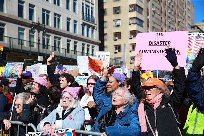 """<p>Demonstrators hold up signs and chant anti-Trump slogans at the """"Not My President's Day"""" rally at Central Park West in New York City on Feb. 20, 2017. (Gordon Donovan/Yahoo News) </p>"""