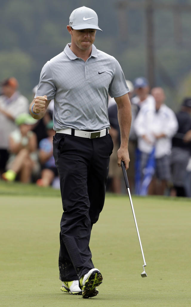 Rory McIlroy, of Northern Ireland, reacts after making a birdie on the ninth hole during the second round of the PGA Championship golf tournament at Valhalla Golf Club on Friday, Aug. 8, 2014, in Louisville, Ky. (AP Photo/John Locher)