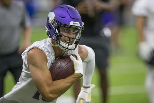 Minnesota Vikings wide receiver Adam Thielen runs after a catch during drills at the team's NFL football training facility in Eagan, Minn. Tuesday, June 11, 2019. (AP Photo/Andy Clayton- King)