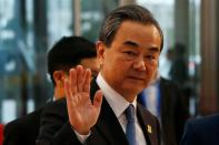 FILE PHOTO - China's State councillor and Foreign Minister Wang Yi waves upon his arrival at the NCC for the Greater Mekong Subregion Summit in Hanoi