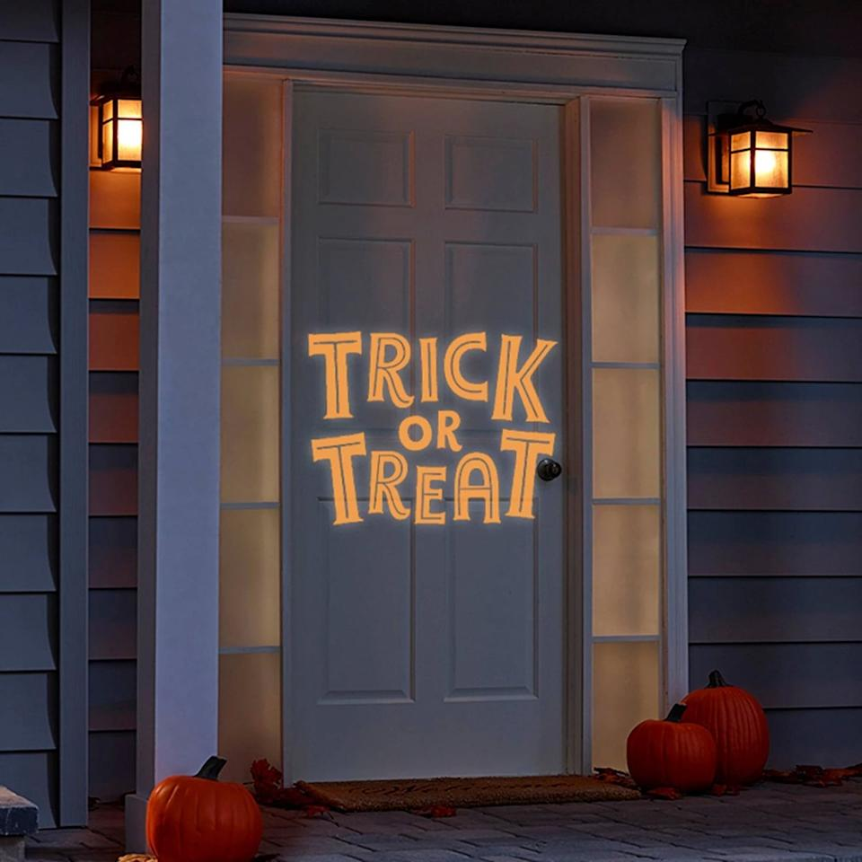 "<p>Greet all ghouls and ghosts into your home with this <a href=""https://www.popsugar.com/buy/Philips-Trick-Treat-Halloween-LED-Projector-479328?p_name=Philips%20Trick%20or%20Treat%20Halloween%20LED%20Projector&retailer=target.com&pid=479328&price=10&evar1=casa%3Aus&evar9=46493516&evar98=https%3A%2F%2Fwww.popsugar.com%2Ffood%2Fphoto-gallery%2F46493516%2Fimage%2F46493847%2FPhilips-Trick-Treat-Halloween-LED-Projector&list1=target%2Challoween%20decor&prop13=api&pdata=1"" rel=""nofollow"" data-shoppable-link=""1"" target=""_blank"" class=""ga-track"" data-ga-category=""Related"" data-ga-label=""https://www.target.com/p/philips-trick-or-treat-halloween-led-projector/-/A-54404582"" data-ga-action=""In-Line Links"">Philips Trick or Treat Halloween LED Projector</a> ($10).</p>"