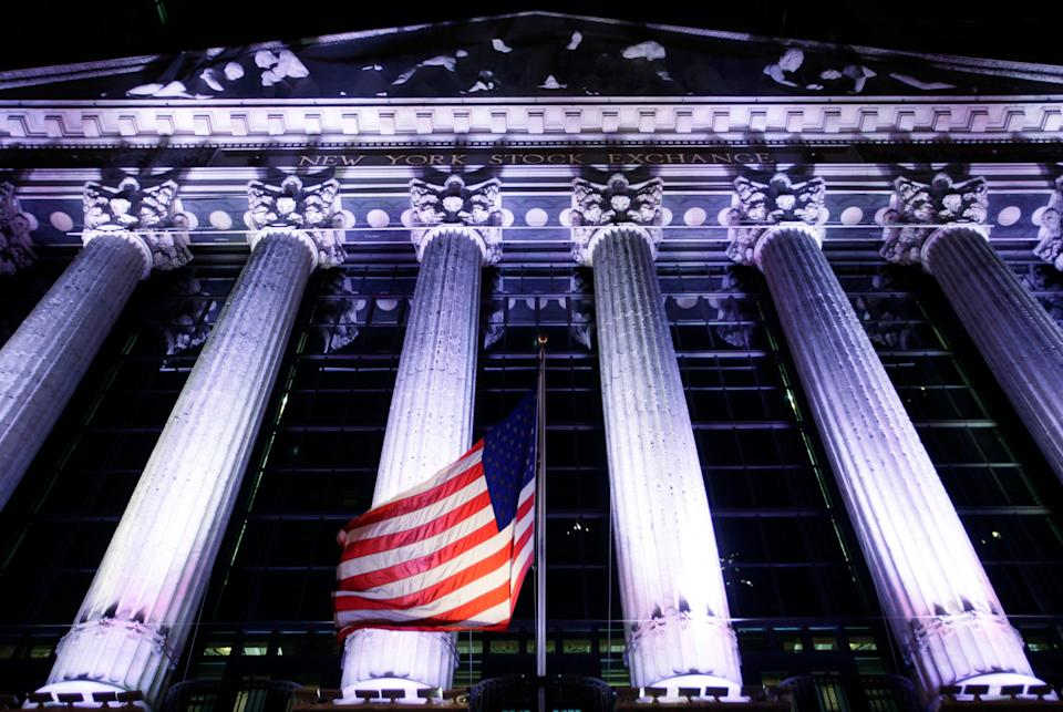 In this Oct. 8, 2014, file photo, an American flag flies in front of the New York Stock Exchange in New York.