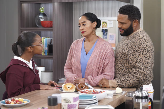 """This image released by ABC shows Marsai Martin, from left, Tracee Ellis Ross and Anthony Anderson in a scene from """"black-ish."""" In the episode airing on Tuesday, Jan. 15, Dre, played by Anderson, and Bow, played by Ross, are furious after Diane, played by Martin, isn't lit properly in her class photo. The episode outlines the history of colorism in depth while injecting some humor. (Ron Tom/ABC via AP)"""