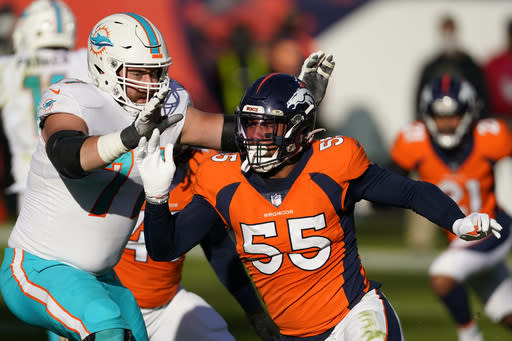 Denver Broncos outside linebacker Bradley Chubb (55) as Miami Dolphins offensive tackle Jesse Davis defends during the first half of an NFL football game, Sunday, Nov. 22, 2020, in Denver. (AP Photo/Jack Dempsey)