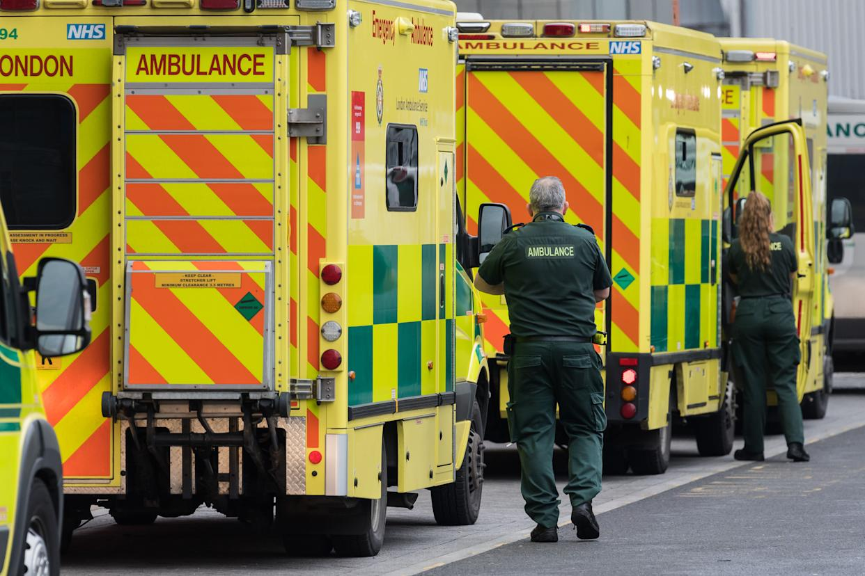 Paramedics stand next to the ambulances outside the emergency department at the Royal London Hospital, on 15 January, 2021 in London, England. Hospitals across the country are dealing with an ongoing rise in Covid-19 cases, providing care to more than 35,000 people, which is around 50% more than at the peak of the virus in spring, with fears that hospitals in London may be overwhelmed within two weeks unless the current infection rate falls. (Photo by WIktor Szymanowicz/NurPhoto via Getty Images)